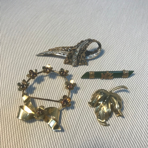 77 - A Lot of 4 antique brooches, Includes 9ct gold lead design brooch, 9ct gold and jade bar brooch, Ste...