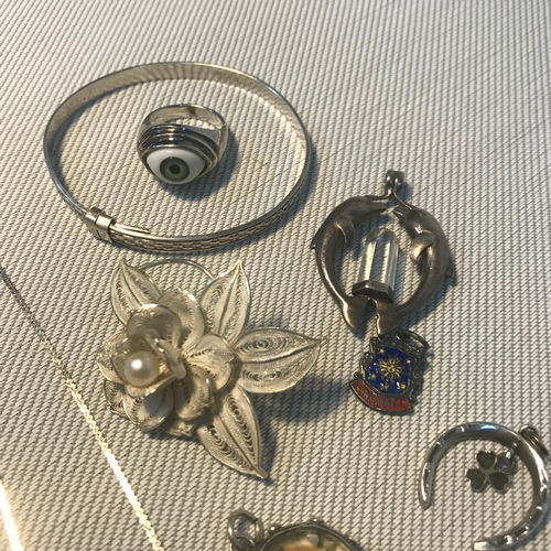 79 - A Selection of silver jewellery which includes Silver double dolphin and clear stone pendant, Gilt a...