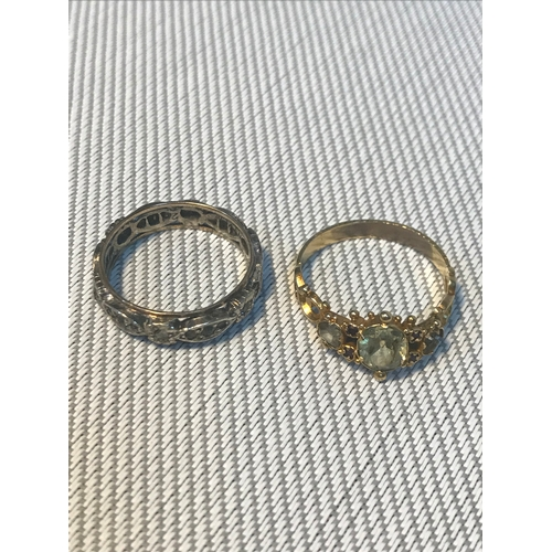 81 - A Yellow metal ring together with a 9ct gold & silver band ring. Total weight 4.25grams....