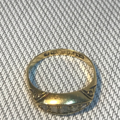 83 - A Birmingham 18ct gold ladies ring set with 5 diamonds, Ring size M, Weighs 2.80grams...
