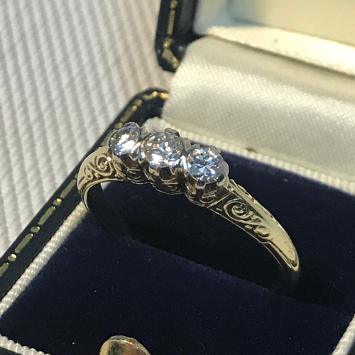 91 - A ladies 14k gold 3 diamond ring, claw set with patterned shoulders, Approx Diamond weight : 32pts, ...