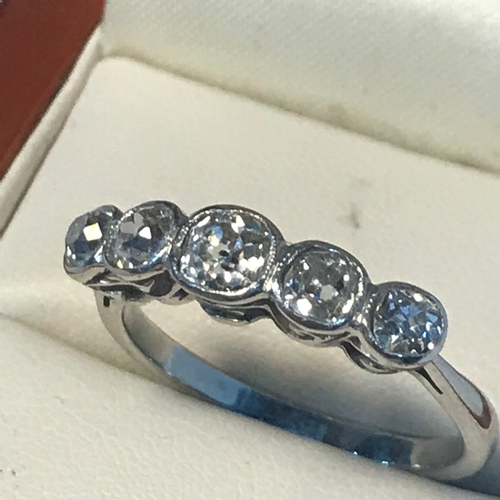 92 - A Ladies 18ct white gold(unmarked) 5x diamond Victorian ring, Cushion cut diamonds in a rubover sett...