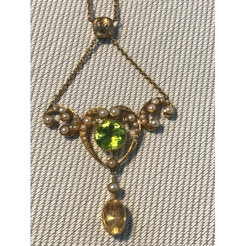 99 - An Art Nouveau 9ct gold ladies evening dress necklace, designed with seed pearls, Large centred gree...