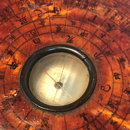 101 - Antique Chinese wooden compass, hand signed to the base. Measures 11.5cm in diameter....
