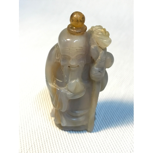 112 - Antique Chinese hand carved perfume/snuff bottle designed in the shape of a monk holding a dragon st...