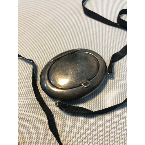 118 - A Birmingham silver ladies compact pendant with black lace necklace, Fitted with mirror to interior,...