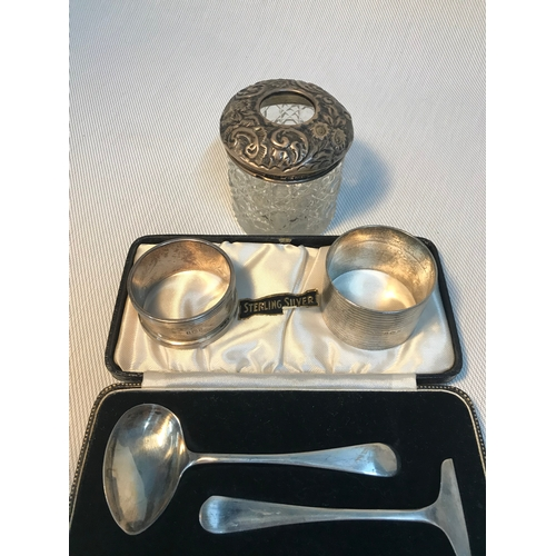 119 - A Birmingham silver topped dressing table jar, Two various sized Birmingham silver napkin rings & Sh...