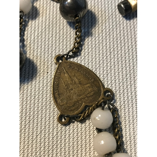 123 - A Set of Victorian prayer beads, made from milk glass beads, silver (white metal) finished with a si...
