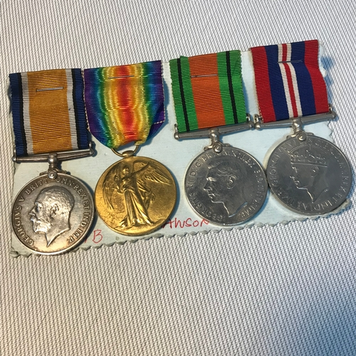 125 - A Set of two WW1 Medals presented to 104517. 1.A.M. J.LAWSON R.A.F. Together with two WW2 medals (no...