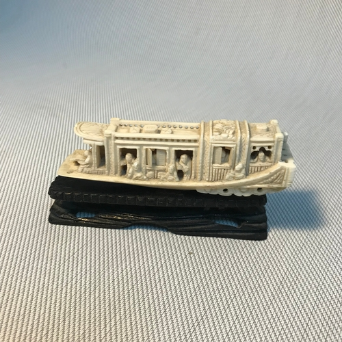 126 - A Chinese Meiji period hand carved ivory junk boat model carved with small figures, open and closing...