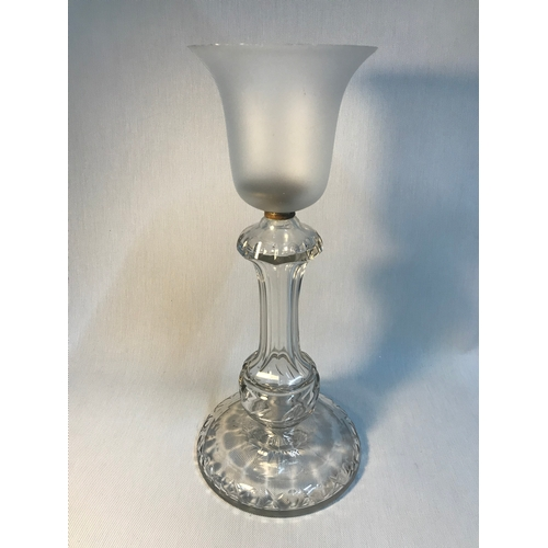 194 - A Victorian cut crystal base with frosted glass shade candle holder, measures 43cm in height...