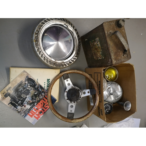 626 - A selection of motoring items to include; steering wheel, a set of four chrome hub caps, petrol can,...