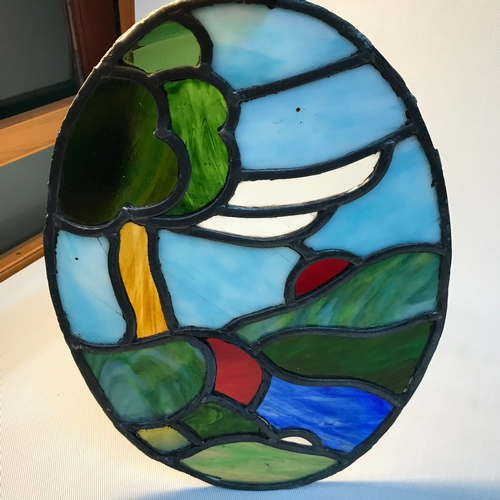 30B - Early 20th century stain glass oval window panel. Measures 36x26.5cm...
