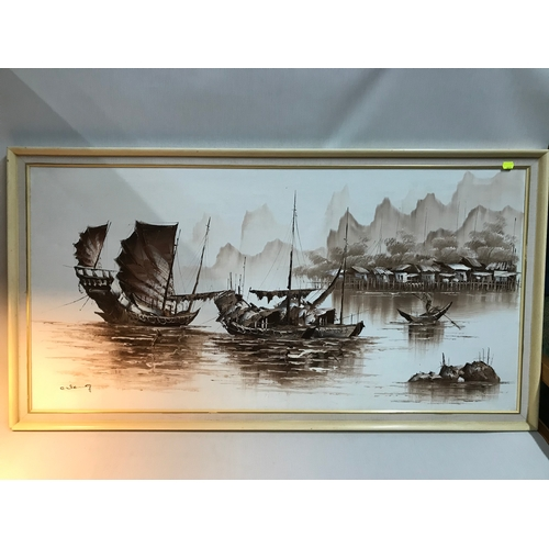 70B - A Large oil painting on canvas depicting junk boats. Signed by the artist. Frame measures 69x130cm...