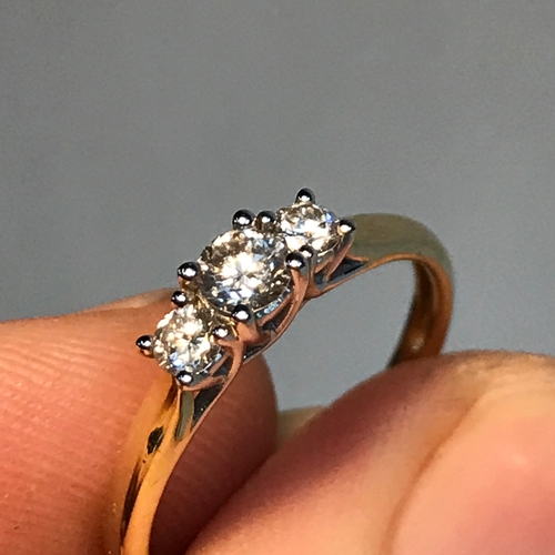 91A - A Beautiful example of a ladies 9ct gold and .33ct diamond ring. Ring size M. Weighs 1.60grams...
