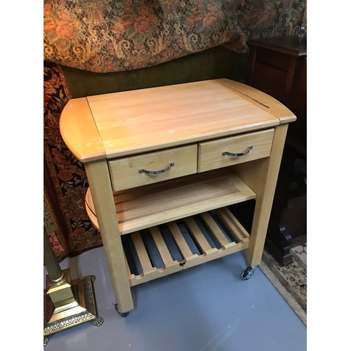 285A - A Contemporary Marks & Spencers solid wood butchers block on wheels....
