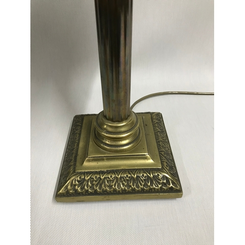 618 - A Heavy brass Corinthian column table lamp, In a working condition....