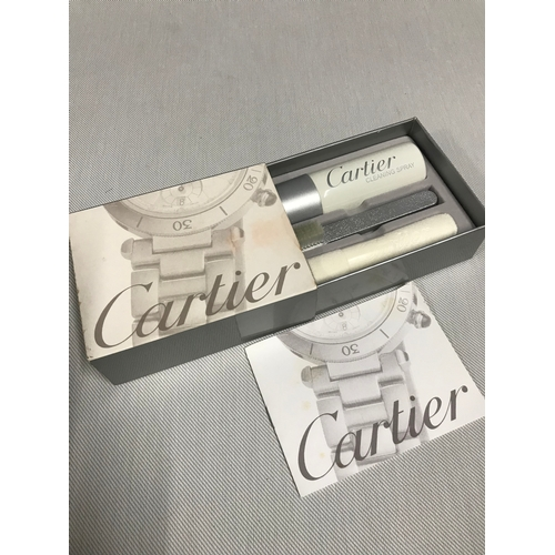 674 - A Cartier watch cleaning kit unused...