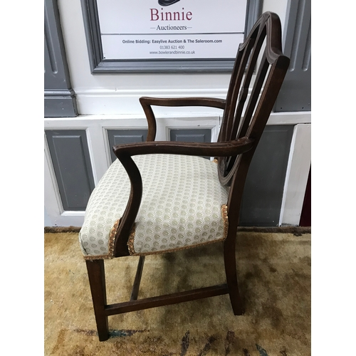 15A - A Georgian parlour arm chair, designed with a shield backing, Recently re- upholstered....
