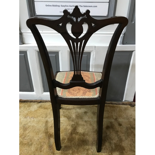25A - An Edwardian chair designed with a Pierced Splat back and supported on Cabriole legs....