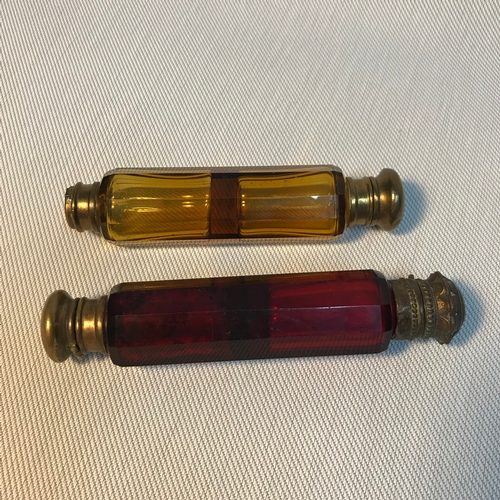 2 - A Lot of two Victorian double end perfume bottles, One designed in amber glass and the other in a ru...