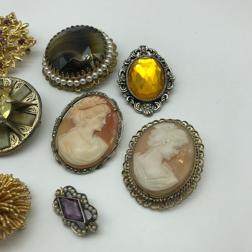 4 - A Lot of vintage brooches to include silver and cameo carved brooches, Silver and cameo carved ring,...