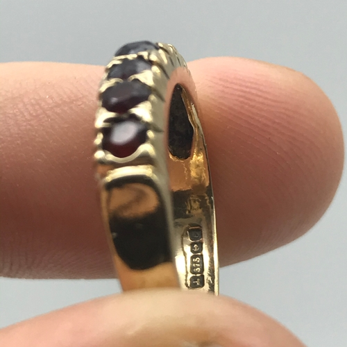11 - A 9ct gold ladies ring set with 7 Garnets. Ring size N. Weighs 3.30grams...