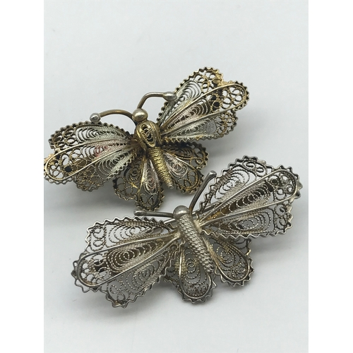 18 - Two vintage filigree silver butterfly brooches....