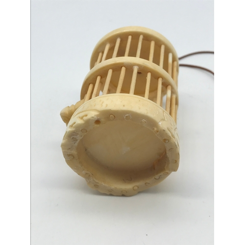 29 - Antique carved bone cricket insect cage. Measures 7cm in height...