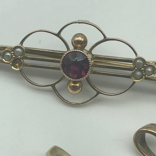 31 - Art Nouveau 9ct gold ladies brooch set with seed pearls and pink ruby style stone. Together with two...