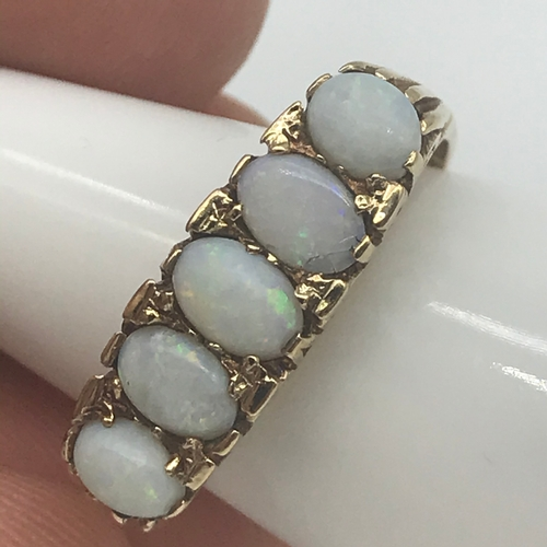 32 - A 9ct gold ladies large set opal set ring, Consists of 5 large opal stones, Ring size Q, Weighs 3.37...