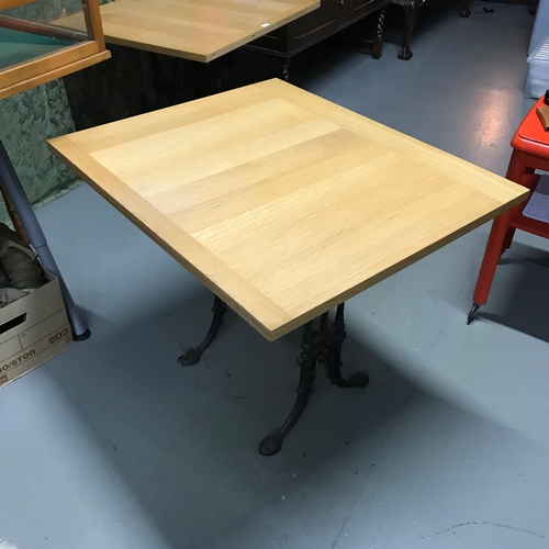134A - A Heavy cast iron base, solid light oak top table, Ideal for kitchen table. Measures 71x90x75cm...