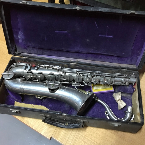 137A - Antique plated saxophone with travel case....