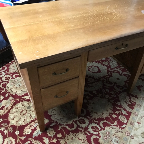 483D - A Solid light wood early 1900's knee hole desk, 5 fitted drawers. Desk measures 77x153x91cm...
