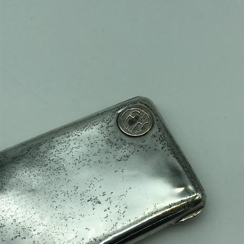 4J - An 875 Silver cigarette case. Designed with raised initials E.H....
