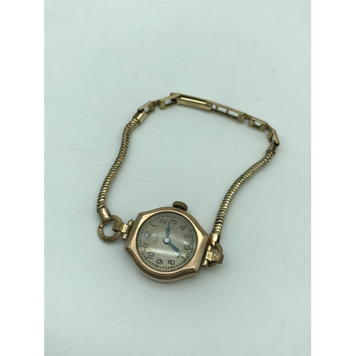 7J - A Mitchell Aberdeen 9ct gold cased ladies watch with rolled gold strap....