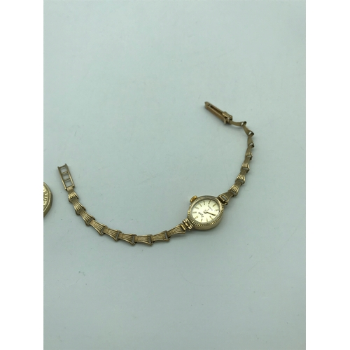 9J - A 9ct gold cased Sekonda ladies watch fitted with a 9ct rolled gold bracelet. In a working condition...