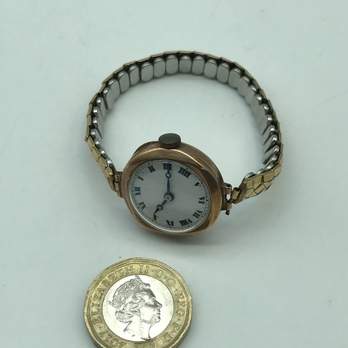 10J - A 9ct gold ladies cased watch with plated bracelet. In a working condition...