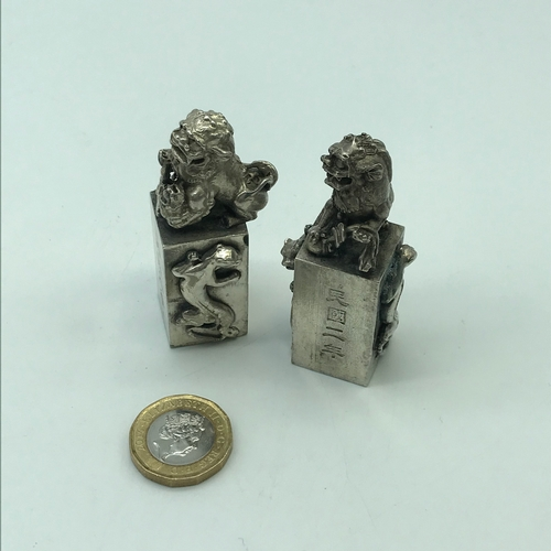 12J - A Pair of heavy white metal Chinese Foo dogs seals....