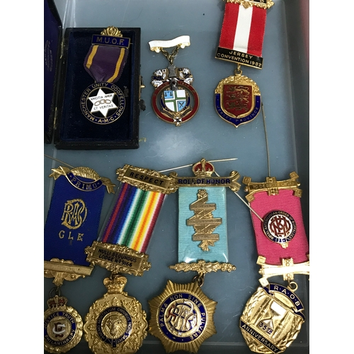 21J - A Lot of Masonic and Roll of Honour Royal Buffalo order medals and ribbons. Includes sash for K.O.M ...
