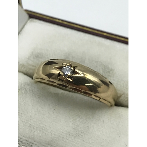 23J - A Gents 9ct gold ring set with a single diamond stone, Ring size R 1/2. Weighs 4.18grams...