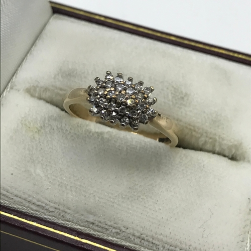 24J - A Ladies 9ct gold ring set with a diamond cluster, Ring size K, Weighs 2.49grams....