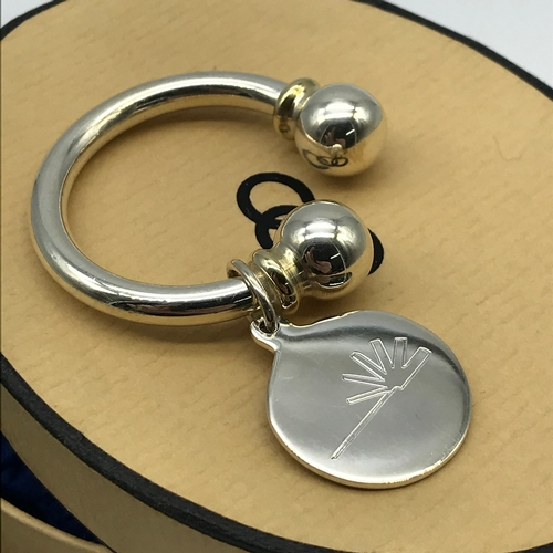 25J - A Genuine Links of London solid silver keyring with certificate card, pouch and box....