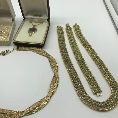 27J - A Lot of vintage costume jewellery which includes 22ct gold lined pendant with opal stone, Lotus pea...