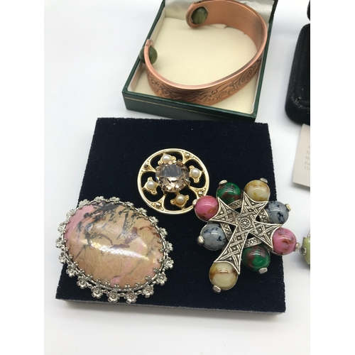 28J - A collection of mixed Scottish and Celtic jewellery which includes Silver Ola Gorie Luckenbooth broo...