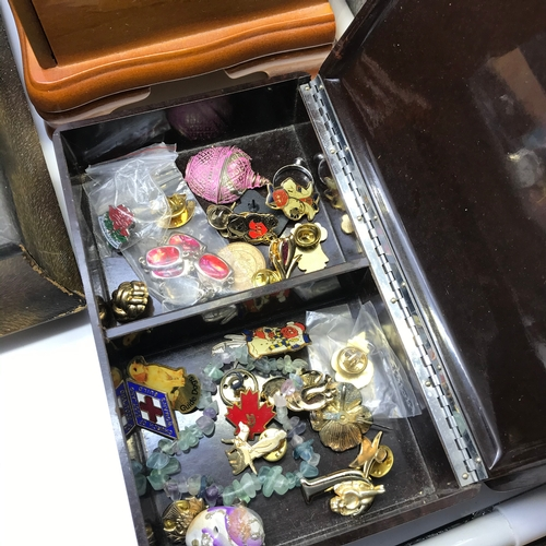 33J - A Lot of costume jewellery which includes Filigree silver fan brooch, various brooches, watches and ...