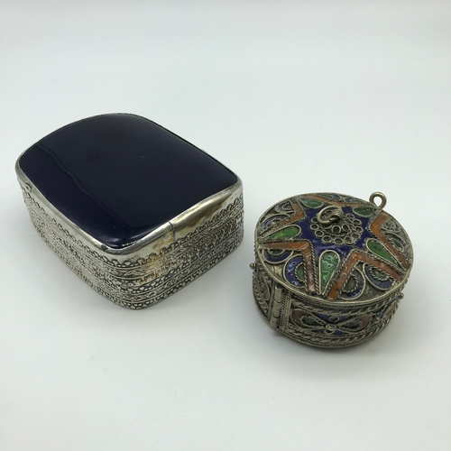 34J - A Lot of two white metal trinket boxes. One is made with white metal and enamel which the trinket bo...