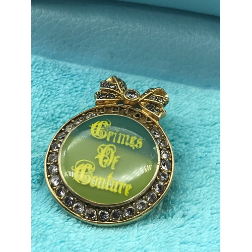35J - A Vintage Juicy Couture Crimes of Couture badge with original box. Together with two Bella Perlina c...