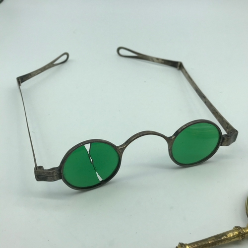 43J - A Set of gilt metal Pince Nez together with two pairs of antique silver framed spectacles. One set h...