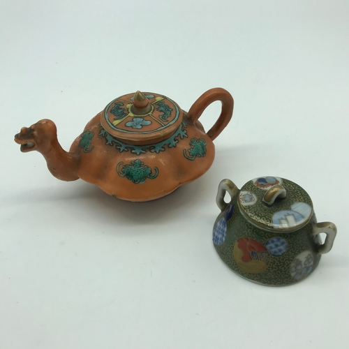 45J - A 19th century orange and green hand painted miniature tea pot set with a dragon head spout. Togethe...
